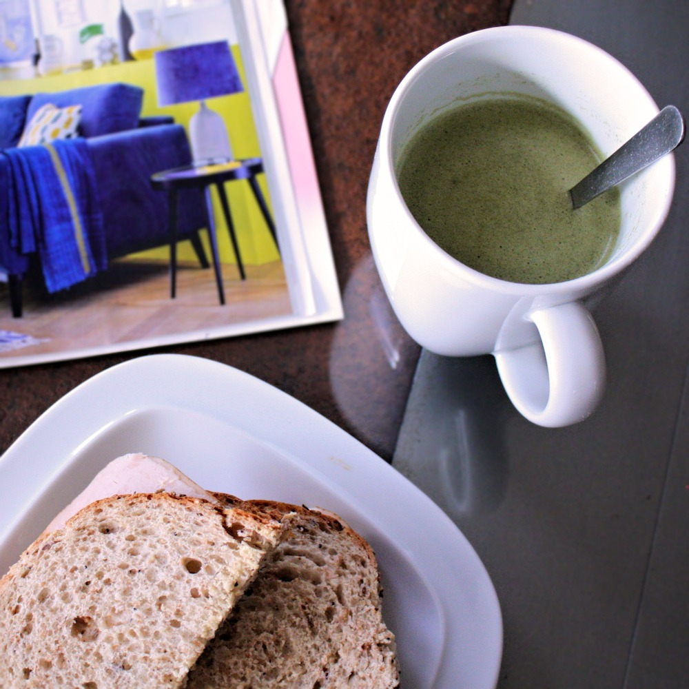 Mug of Eat Clean Diet Whey Broccoli Soup with wholegrain turkey sandwich