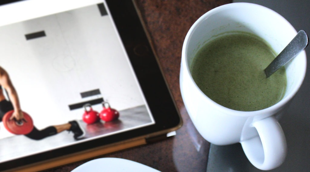 Eat Clean Diet Whey Soup in mug with  iPad showing workout